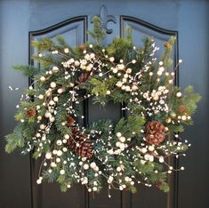THIS IS A RESERVED LISTING FOR A 3FT SWAG WITH THE SAME MATERIALS HERE, WINTER PINE AND CREAM BERRIES WITH A GRAPEVINE HANDLE.    Holiday Wreath -