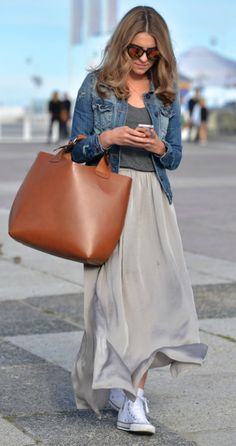 Katarzyna Tusk enters summer with a wonderful combination of a grey maxi skirt and tee topped off with a light denim jacket.  Shops: not specified