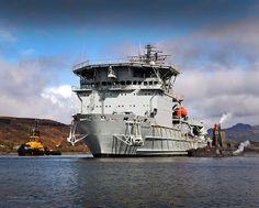Royal Navy Astute class submarine HMS Ambush is pictured alongside the forward support vessel RFA Diligence in Gareloch, HMNB Clyde, Scotland.