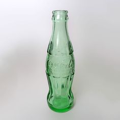 Kentucky, Louisville - Vintage Empty 6 oz. Hobbleskirt Embossed Coke Bottle - BTCE168 - Empty vintage Coke bottle Louisville, Kentucky - Vintage empty 6 oz. green glass hobbleskirt Coca Cola embossed Christmas Coke bottle
