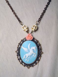 Skulls, roses unicorn pendant