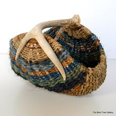 {antler woven basket}  Have one that I love!!  Need to get it out again and put some cool stuff in it