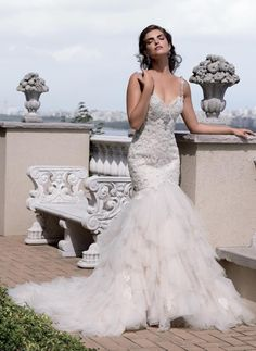 Tasteful Eve of Milady wedding dresses; click to see more gorgeous gowns from this collection.