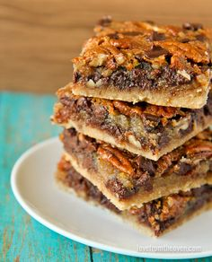 These pecan pie bars are kicked up a notch with the addition of chocolate chips. Perfect for holiday baking! The flavors of pecan pie, in bar form!