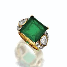 EMERALD AND DIAMOND RING, CIRCA 1950. The square emerald-cut emerald weighing approximately 7.30 carats, flanked by 2 pear-shaped diamonds weighing approximately 1.80 carats bordered by numerous small round diamonds, mounted in gold,