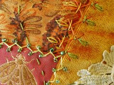 Orange crazy quilt with beading, stump work embroidery , cloth motifs and crazy quilt stitching.