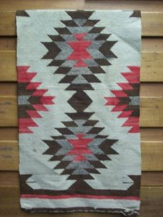 This beautiful Navajo rug was most likely made in the 1930s or 1940s. Its a Gallup throw rug, named after the town in which it was made - Gallup, New