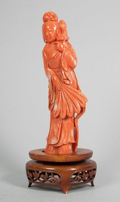 Chinese carved coral maiden figure mounted on wood base, 8 1/2 in. H.