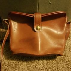 Coach Bag Vintage brown all leather coach bucket bag with adjustable strap. Small blemishes from natural aging and slightly worn bottom. Very beautiful cognac color. Coach Bags