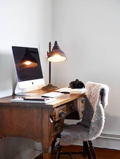 The juxtaposition of this modern fluffy chair and an antique-inspired desk is everything #getguilded