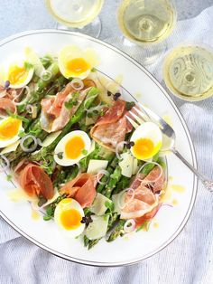 Asparagus Salad with Eggs and Prosciutto: with soft-boiled eggs, al dente asparagus, pea shoots, Asiago cheese, prosciutto and a lemon-Dijon Vinaigrette.  http://tasteandsee.com