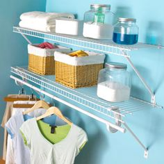 Double-Duty Shelving Plastic-coated wire shelving from ClosetMaid (closetmaid.com) puts wall space to good use. Keep laundry supplies attractively organized in clear canisters and cloth-lined baskets. The clothing rod is perfectly positioned for drip-dry items.
