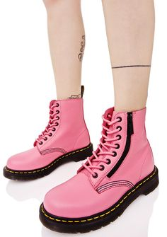 Dr. Martens Pink Zippered Pascal 8 Eye Boots are gunna get on tha down beat stomp, babe! Get yer legs kickin' with these totally classikk combat boots, featurin' a buttery soft bubblegum pink leather construction, side zip details, thick ass treaded soles, cushioned footbed, signature yellow stitching, AirWalk pull tabs, and full length lace-ups.