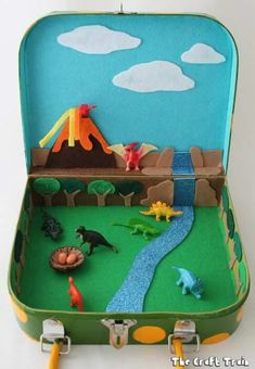 Dinosaur small world in a suitcase dinosaur crafts kids, dino craft, dinosa Dinosaur Small World, Small World Play, Dinosaur Land, Dinosaur Toys, Diy For Kids, Projects For Kids, Crafts For Kids, Fall Projects, Cool Gifts For Kids