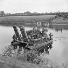 Universal carrier of 53rd Anti-Tank Regiment being ferried across a river near Tanfield in Yorkshire using assault boats and pontoons by men of 16th Field Squadron, Royal Engineers, 10th June 1942