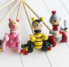 Wooden Push Along Pig Toy  A great wooden pig push along toy that helps kids to get mobile. This fun little guy will keep them amused for hours! It is a handpainted wooden push along toy which is so cute and friendly and could become a new friend to a child when nervous about making those first steps. They can push them as they walk and the beads on their wheels spin adding to the enjoyment. We have 10 designs to choose from, so that every child can have their favourite animal or character.
