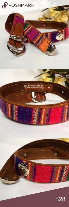 Leather with woven textile and silver conchos Handmade in Guatemala, this belt has all the exotic beauty and craftsmanship reflecting the culture!  Length is 33 inches with holes for adjustment at 26, 27, 28 and 29 inches. Constructed to be around for years, adding a splash of culture and uniqueness to your closet.  The sky is the limit here Accessories Belts