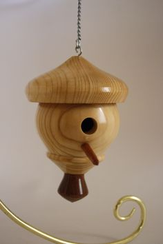 This decorative birdhouse is made out of Pine and Walnut (Pine body and roof with Walnut bottom finial). This birdhouse is slightly larger in size and particularly diameter, measuring 4.5 inches from