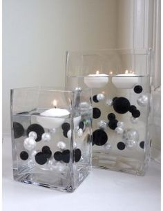 """These would make cool centerpieces!""  -I bought the water beads off of amazon, I think 3 packages, they are super small, but you add water and it makes a ton! I put them in fish bowls with red and black beads from a local craft store, afterwards, lay them out and they dry! Very neat!"