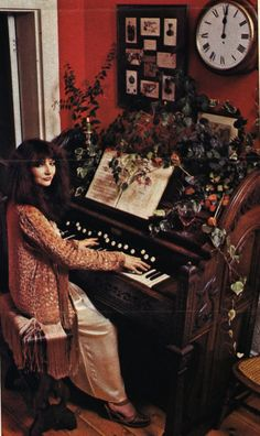 "Kate Bush at an old piano, wearing a very fragile, flocked velvet and fringed flapper jacket from the Kate is wearing it over a satin nightie. Picture is from an article ""Tales Of Christmas Past"" by Jan Etherington, Christmas 1978 Divas, Before The Dawn, Dc Comics, Wuthering Heights, Women In Music, Christmas Past, My Music, Music Pics, Music Artwork"
