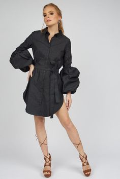 Channel your inner high fashion self in the Kimberly Denim Shirt Dress. This dress has dignified puff sleeves that give it the dimension and poise of a woman with confidence.