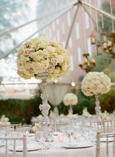 Distressed candelabras with winter white hydrangeas and blush roses put into champagne gold candelabra instead and drape strung pearls