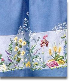 Oslo bunad embroidery on skirt.      After WW2 a committee formed to invent the Oslo Bunad. My Mother in Law, Signe Marie Eriksen. was a  member. The embroidery was her idea as wildflowers were a great love of her life.  She made a bunad for ech of her grandson's wives and her self and her Daughter in Law.