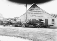 Premises of A Smith & Sons, coal and produce merchants and carriers, 8 Taupo Quay, Wanganui, 1925. Four trucks bearing the firm's name are parked in front of the building. Taken by an unidentified photographer.