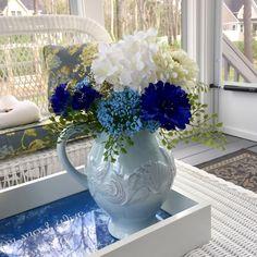 Lovely coastal cottage arrangement set in a pale blue sea theme ceramic pitcher.