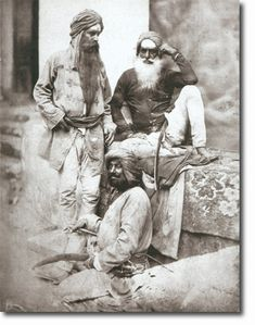 H H 1858. The officer on the left is Man Singh who achieved great reknown in the history of the regiment. The man sitting on the wall is Jai Singh who had a long and eventful military career. The other man on the ground, is Goormuck Singh