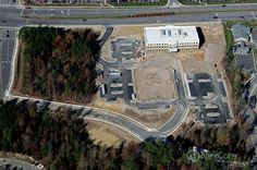 The Rex Healthcare of Knightdale campus is located at the intersection of I-540 and US Highway 6. This high-traffic retail and residential location ensures excellent visibility for healthcare providers and convenience for patients. This aerial photo was taken in 2009 as Phase I of the campus (the 63,600 SF MOB) was under construction. Phase II of the campus (a 34,000 SF Wellness Center ) was completed in 2012. Wellness Center, Under Construction, Workout Programs, City Photo, Health Care, Medical, Retail, Training Programs, Medicine