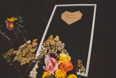 To commemorate their tropical celebrations, Vickie and Daniel had their wedding guests sign wooden pieces and drop them in the shadow box!   Click for more unique wedding guestbook ideas!