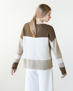 Symmetrically aligned blocks of solid and marled colors help create canvas of this oversized pullover. Mostly striped and worked with hint of intarsia to merge the bigger blocks, the pullover is ac…