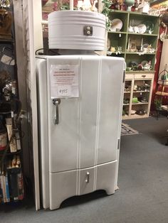 1927 General Electric refrigerator model # 6408840 -Works priced at $395 from dealer 403 booth 80