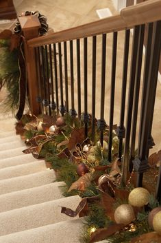 Place Garland at the Bottom of Stair Railings - from  http://nomadicdecorator.com - allows you to still use the handrail.------------ maybe more colorful