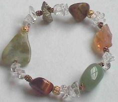 """Crystal Bracelet for Good Luck jade - good luck, prosperity •citrine - """"merchant stone"""", improves business, attracts money •aventurine - good luck especially in games of chance, attracts money •iron pyrite - """"fools gold"""", attracts money into your life •tiger eye - financial stability, prosperity, manifesting your desire  •unakite - prosperity and """"abundant harvest"""" •quartz - good luck, harmonize the energies of other stones"""