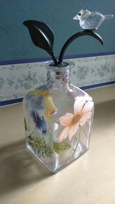 Square glass bottle with foral pattern