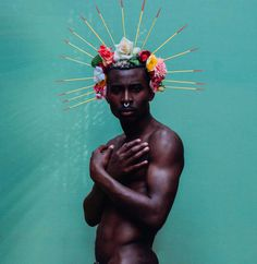 Photographer Lynette Luna teamed up with model Nana Ansah to make 'Black Men with Flowers,' a photo series about Black men and sensitivity.