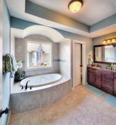 Cherry Creek II floor plan - beautiful bathrooms - light blue and silver - decor - master bath - oval tub - tile