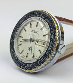 RAKETA CITY- Rotating bezel, world time zones. RARE Vintage Mechanical Watch. SERVICED CLEANED AND OILED by a professional watchmaker. CASE DIAMTER EXCLUDING CROWN IS 1,7 ( 4,2 сm). The watch has a State Quality Mark, which is depicted on the dial Mechanical movement. Real leather watchband as the photo Vintage mechanical mens USSR (Soviet Union) RAKETA made in USSR in Petrodvorets Watch Factory (in Saint Petersburg). The Petrodvorets Watch Factory is Russias oldest factory. SHIPPING WORL...