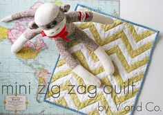 Love the sock monkey and even more this darling chevron quilt!! (Oooh, another project for Oma!!)