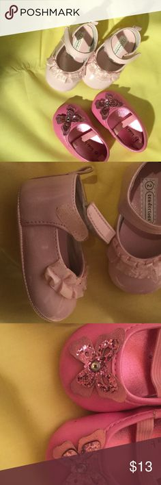 Baby girl shoe bundle in pinks size 2 worn once Baby girl shoe bundle of a pale pink Mary Jane style with side Velcro closure and delicate toe ruffles. The other a hot pink slide on with elastic top strap and sparkled from toe butterflies. Super cute and useful for the mom who uses lots of pink!! Size 2 and worn once tendertoes and koala baby  Shoes Baby & Walker