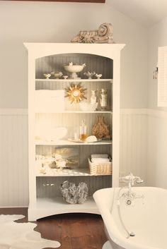 The master bath wall and ceiling color is Benjamin Moore's Horizon OC- 53 in eggshell finish.   All woodwork is Benjamin Moore White Dove in Latex Satin Impervo.  So soft and soothing!
