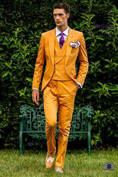 Italian bespoke orange pure cotton suit with peak lapels, 1 corozo button, ticket pocket and double vent. 100% cotton fabric. Fashion suit 1924 Fashion Color Collection Ottavio Nuccio Gala.