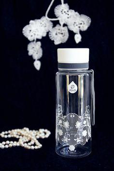 White lace bottle on black background