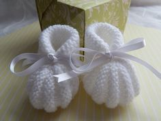 A personal favourite from my Etsy shop https://www.etsy.com/uk/listing/198588372/knitted-white-baby-booties-christening