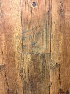 It's called Historic Oak Timber, and it's from the Restoration Collection made by Mannington (100% American made I might add!)