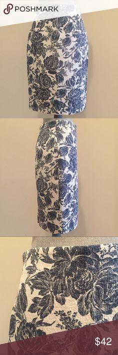 Skirt Beautiful vintage inspired French blue floral skirt in a cream background, with the appearance of s hand stitched background in a comfortable, lightweight fabric. Center back invisible zipper with a hook and eye closure. Features a hem vent for comfortable walking. Fully lined. 23 inches from top of waistband to hem. Ann Taylor Skirts Pencil