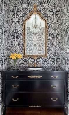 black and white home decor. Love the mirror and the wallpaper in this bathroom