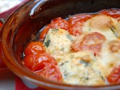 If you haven't tried gnudi, now is the time. These naked ravioli are really ricotta are mixed with a small amount of flour and optional ingredients (here, spinach and garlic), then baked into cheese balls.